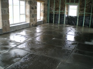 Laying of new Caithness Flagstone floor as part of barn renovation at Forsanain